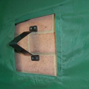 Anka Point AnkaPoint security bracket fitted to wall through rear flap in TidyTent