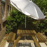 UV Garden Parasol on bench