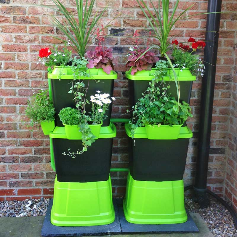 Brighten up your garden with this bright green and black rain water butt