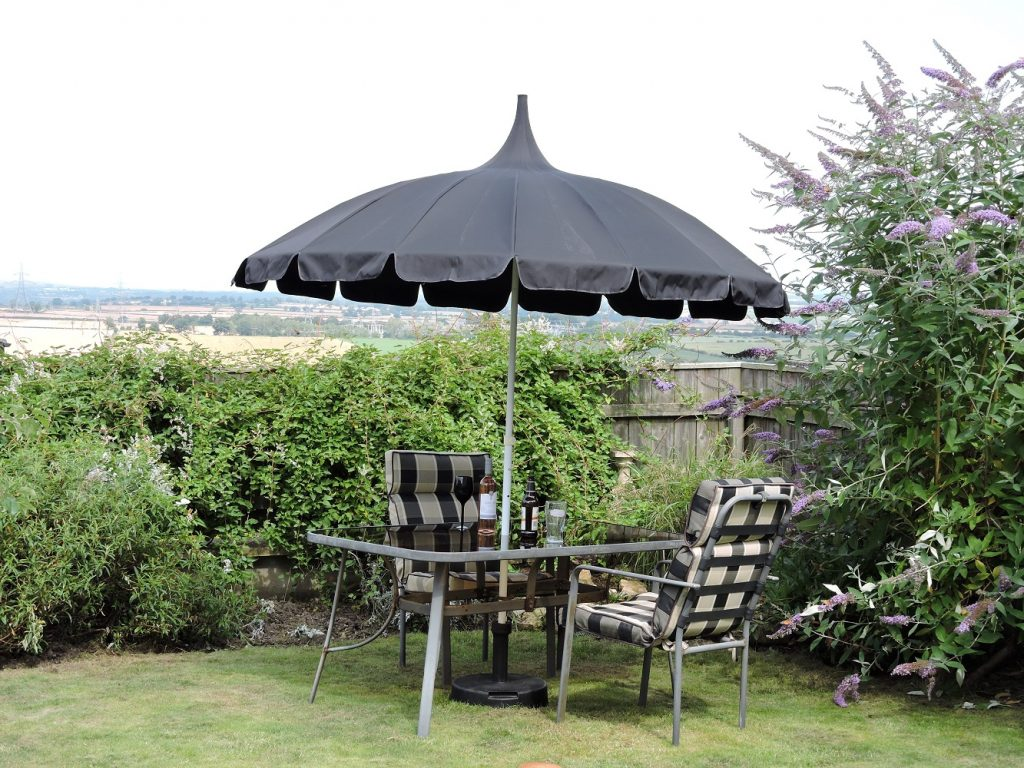 Pagoda Garden Parasol in Debs Garden - all black canopy